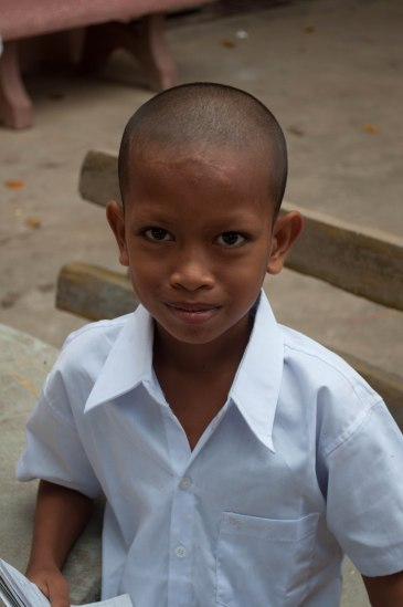 Doing well: He's a boy and his shirt is still a crisp white in the dust of Cambodia. Wat Prek Ambel, Prek Ambel Village, Kandal, Cambodia